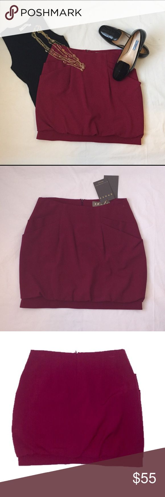 Space Fuchsia Bubble Hem Skirt Made in Italy, Size 44 (US 8). 43% Virgin wool, 52% Polyester, 5% Lycra. Above the knee; 4 front pockets. Never worn, new with tags. Bubble hem detail looks especially lovely against black matte tights or golden legs. Prada loafers sold separately, all other items not available. Space Skirts
