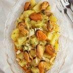 Patatas alinadas con mejillones