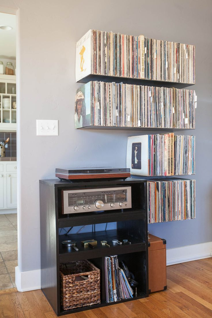 Custom metal floating record shelves.  SUPER WANT.