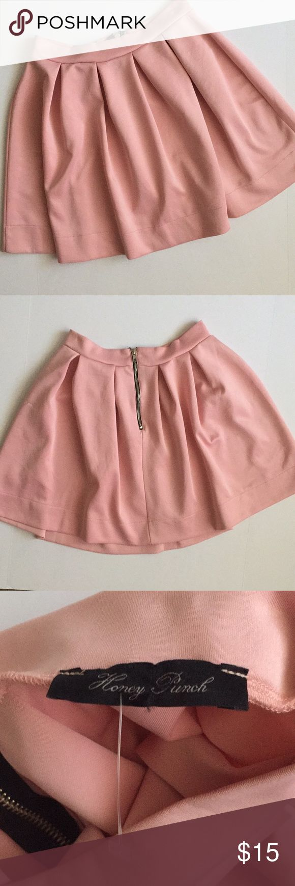 "Pink pleated mini skirt by Honey Punch Girly pink pleated skirt with black and silver statement zipper down the back.   ❗️as pictured, this item is a little damaged. Small splattered stains (hard to see), pulled thread on the back, several areas of minor pilling and pulling, indentations from clothing hanger on waist❗️  Measurements are approximate:  Length- 17"" Waist- 13""  96% polyester 4% spandex  Size Large (L) Honey Punch sold by Nasty Gal Honey Punch Skirts Circle & Skater"
