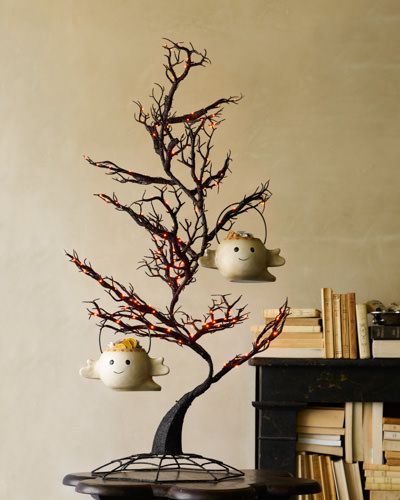 Create luminous Halloween charm and hang your petite candy bowls on these spooky Tabletop LED Trees.