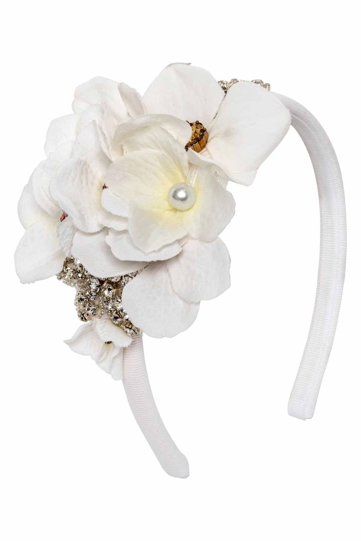 Ivorygrosgrainheadband embellished with a beautiful composition of shiny Swarovski flowers, hydrangeas and pearls.
