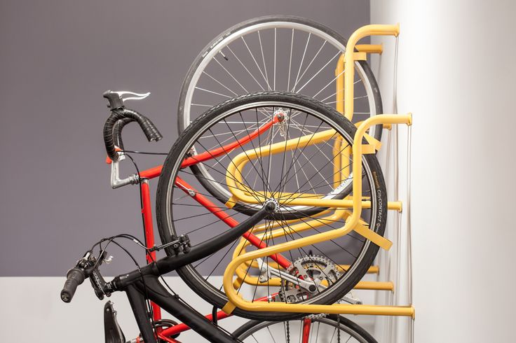 PUSHBIKE CRADLE - Designed for bike riders not weight lifters, this vertical parking rack cradles the front tyre, reducing lifting issues normally experienced with vertical parking #bikerack #pushbike #makecyclingeasy #cycling #endoftrip