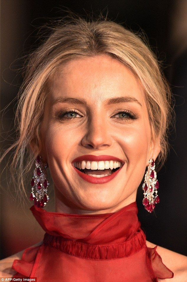 Stunning: The blonde styled her locks into a chic up do, while a flawless slick of red lipstick was the final touch