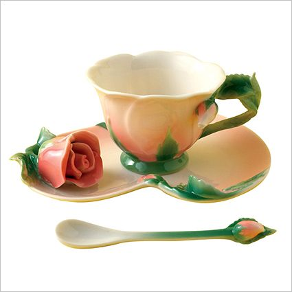 Two's Company Rose Tea Set:  A delicately sculpted saucer and matching cup in a deep rose shade with a sprinkling of blossoms in handpainted porcelain. What better way to celebrate tea time. Three piece set includes teacup, saucer and spoon.  4