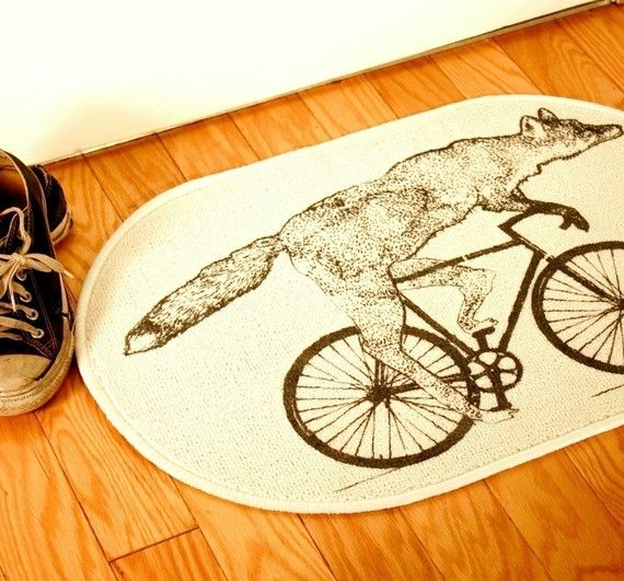 Door Mat with Screen Printed Fox on a Bike on a Natural Creme White Rug - Bath Mat