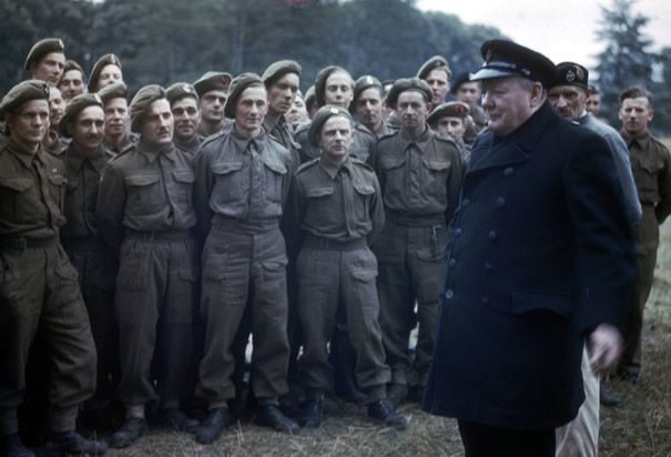 Winston Churchill with D-Day Veterans: July 22, 1944. In Caen, France Prime Minister Winston Churchill speaks to veterans of the D-Day invasion of Normandy. (Photo Credit: Corbis)