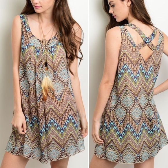 Boho dress Sleeveless dress features a scooped neckline, tribal print all over in browns and blues with a relaxed fit. Criss cross back. Petite sizing. Lined. 100% polyester. Not interested in trades. Dresses