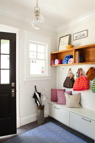 Bright, new mud room design with custom built-ins, custom textiles and modern glass/metal lighting.