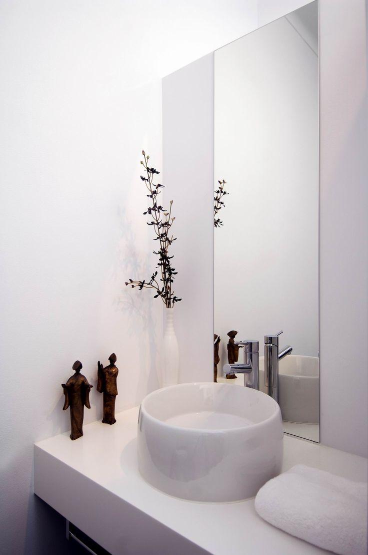 Guest Bathroom hides laundry behind. Brooke Aitken Design.