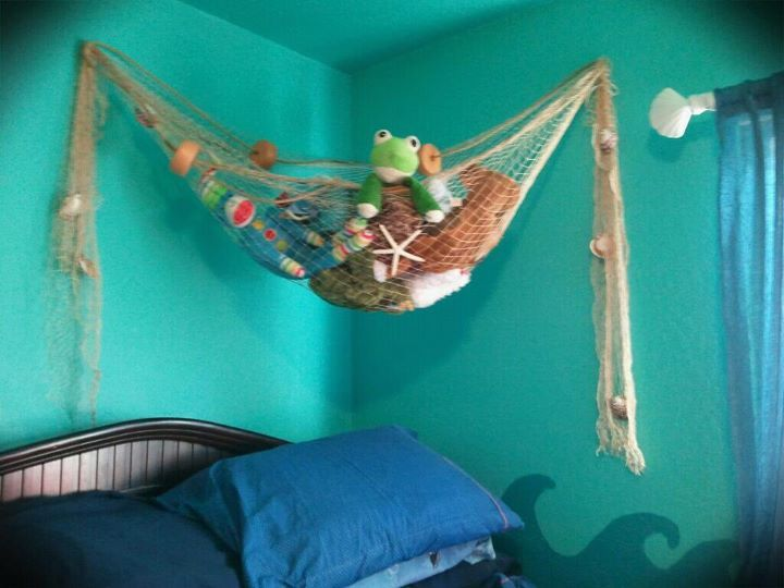 stuffed animal storage above the bed