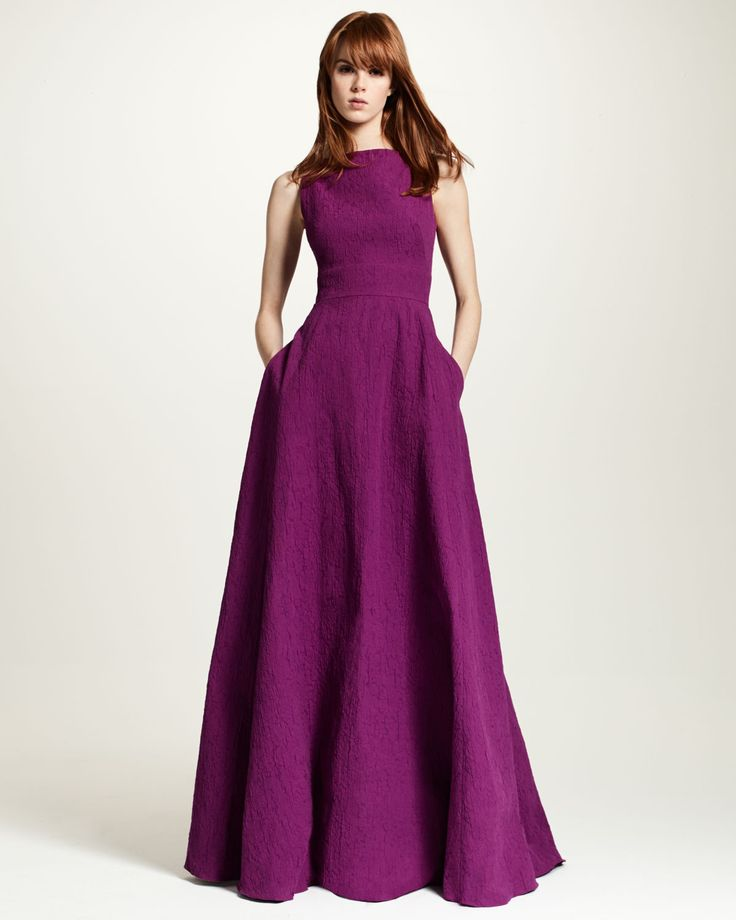 Lela Rose matelasse gown. Bateau neckline; V'd back. Sleeveless; moderate shoulder coverage. Fitted bodice; full skirt. Seam across the waist. Hem falls to the floor. Slight train at back. Cotton/poly