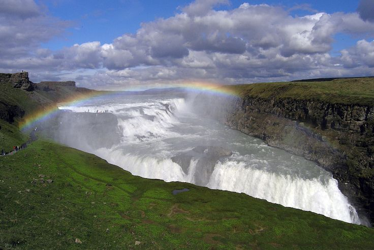 """Though Iceland is known for many of its waterfalls, none is perhaps as beautiful as Gullfoss, located on the White River (""""Hvítá""""). Translated from Icelandic, its name means """"Golden Falls."""" What makes the falls particularly stunning is that they traverse over three massive """"steps,"""" plunging onto two stages, and then down a 32 meter (105ft) deep crevice. This creates the allusion that the falls are perching above an abyss—albeit probably much better looking than you'd imagine an abyss."""