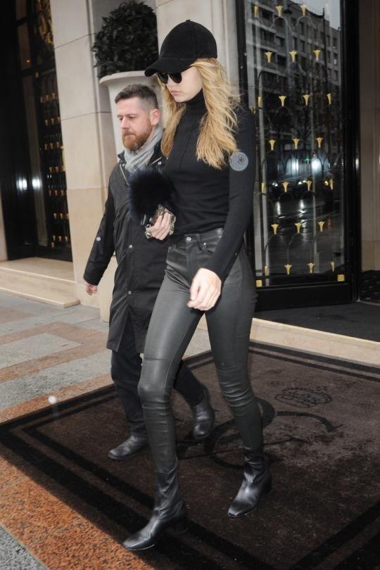 Gigi Hadid wearing Vianel Cream Lizard Iphone Case, Emm Kuo Majorelle Black Fox Bag, Sandro Paris Amele Ankle Boots and Vianel Suede Hat in Black