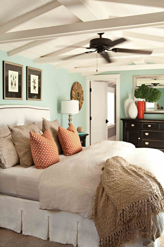 Master Bedroom With A Spa Feel Sea Foam Green Paint On The Walls With Neutral Bedding Pleated Bed Skirt Upholstered Headboard And A Pop Of Color With