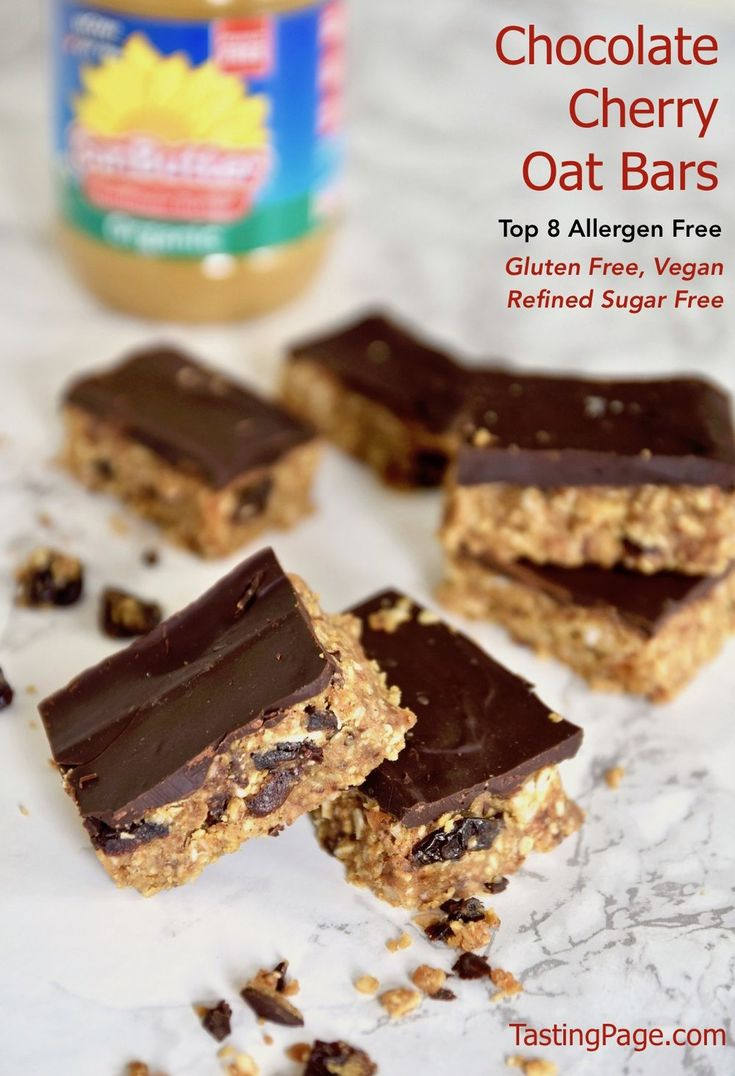 Enjoy these chocolate cherry oat bars at your next party. Indulge in this dessert that is free from the top 8 allergens. It's gluten free, vegan and free from refined sugar. | TastingPage