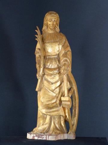 Sculpture dorée de Sainte Catherine d'Alexandrie tenant la palme et la roue de son martyre, 18ème siècle