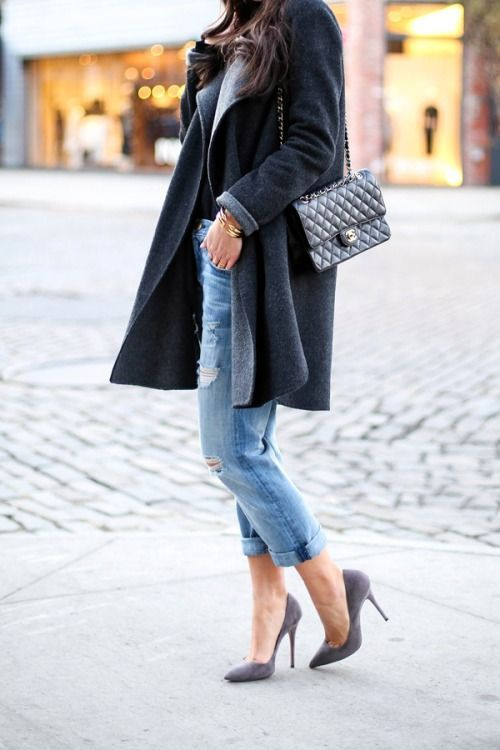 We adore this outfit for a fall day on the town. Ripped boyfriend jeans dressed up with a black coat, Chanel boy bag, and grey suede heels.