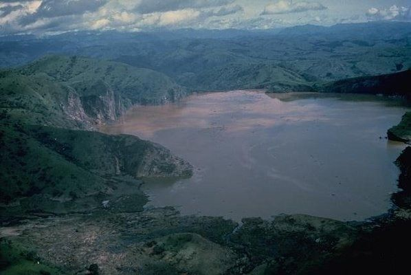 Lake Nyos   Atlas Obscura- August 21, 1986, something in the lake went off. It is unknown what the trigger was – landslide, small volcanic eruption, . In what is known as a Limnic Eruption, the lake literally exploded, sending a fountain of water over 300 feet into the air and creating a small tsunami. But far more deadly than the water was the gas. Some 1.2 cubic kilometers of CO2 was released in roughly 20 seconds. This wave of deadly gas swept over the countryside. In Nyos only six out of…