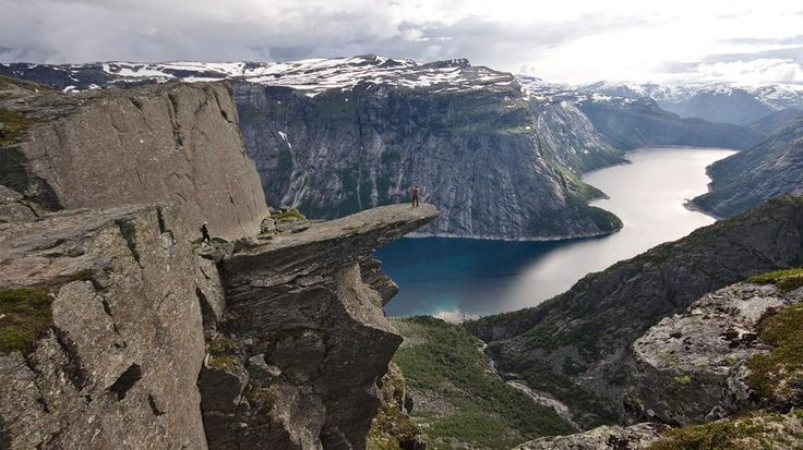 The Trolltunga cliff in Norway hangs horizontally out of a mountain about 700 meters above Ringedalsvatnet lake overlooking the valleys of the Hardanger region. It has no safety railing. (Wikimedia/TerjeN)