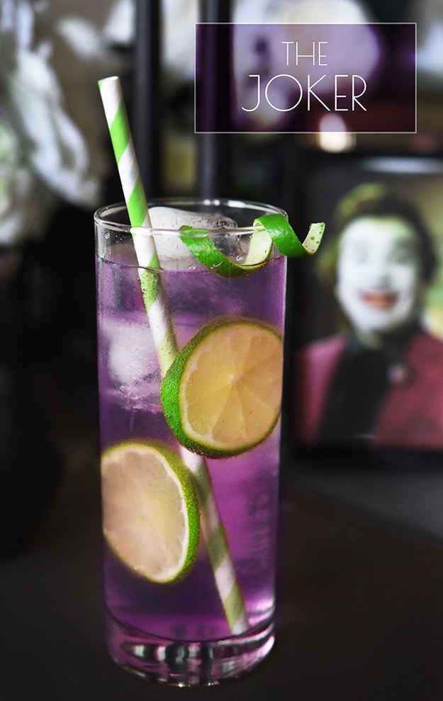 The Joker Serves 1  3 oz. grape Jolly Rancher-infused vodka (see below)  ¼ oz. lime juice Seltzer  To make the infused vodka: Unwrap 10–12 purple Jolly Ranchers and put them in a sealable jar or bottle. Add 1½ cups of vodka, seal, shake, and let sit overnight or until candy fully dissolves when you shake the bottle. Chill until ready to use.  Add 3 oz. infused vodka and lime juice to a Collins glass with ice, stir, and fill with seltzer. Garnish with lime slice.