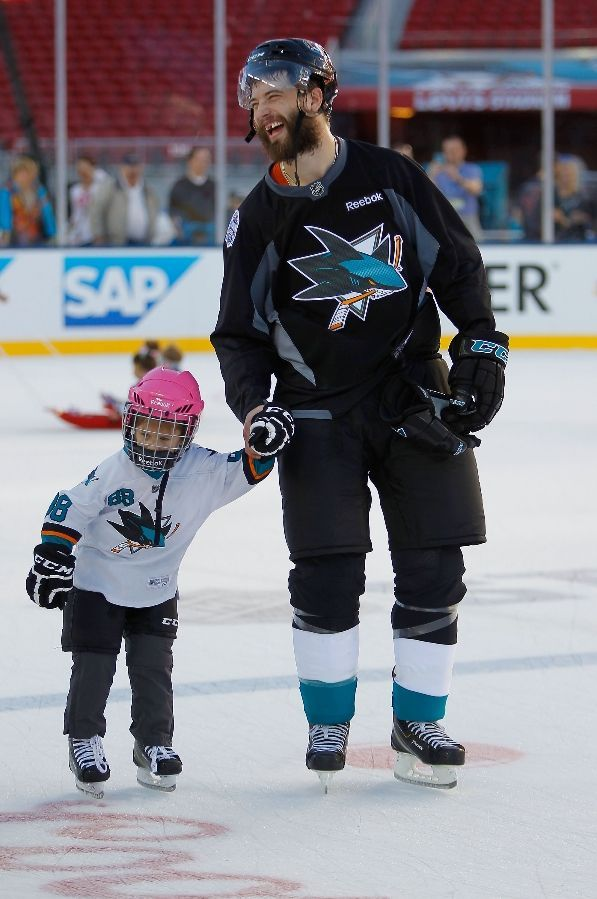 San Jose Sharks defenseman Brent Burns skates with his daughter Peyton during the family skate session at Levi's Stadium (Feb. 20, 2015).