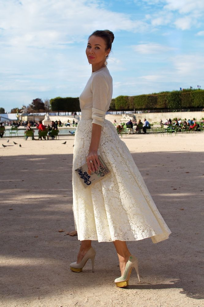 Full ivory lace skirt, ivory blouse and platform pumps, high bun