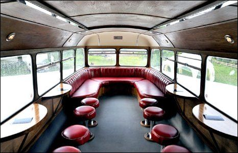 I love the half round tables! double decker restaurant - Google Search
