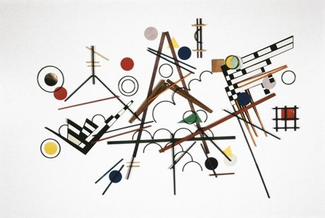 Vasily Kandinsky's Composition 8 from 1923, recreated with kindergarten gifts number 7 (paper parquetry), 8 (sticks), 9 (rings), 14 (weaving), 15 (slats), and 16 (jointed slats).
