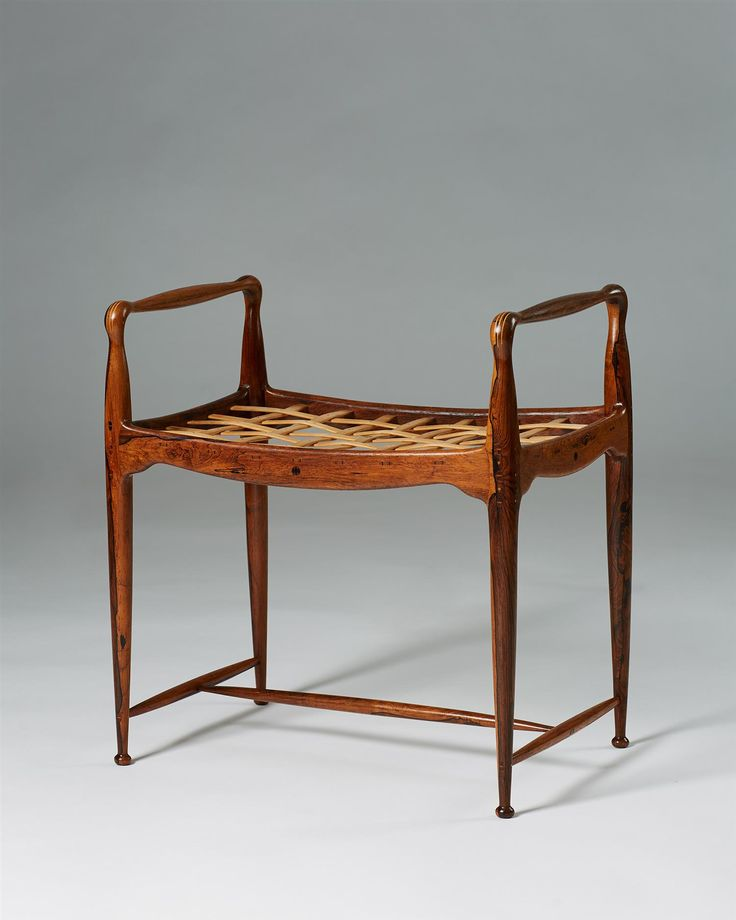 Brazilian rosewood, ash with boxwood inlays, maple interwoven seat. Provenance: private Danish collection. H: 56 cm/ 22'' Seat height: 40 cm/ 15 3/4'' W: 52 cm/ 20 1/2'' D: 36,5 cm/ 14 1/4'' Signed underneath by the designer. Similar model registered as number RP05615 in the furniture index of Design Museum Danmark Literature: 40 years of Danish furniture design : the Copenhagen Cabinetmakers' Guild exhibitions 1927-1966 ; Dan...