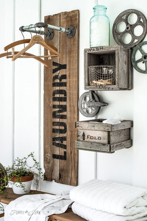Creating an industrial farmhouse reclaimed wood and pipe LAUNDRY sign hanging station with crate shelves, with Funky Junk's Old Sign Stencils and Fusion Mineral Paint | funkyjunkinterior...