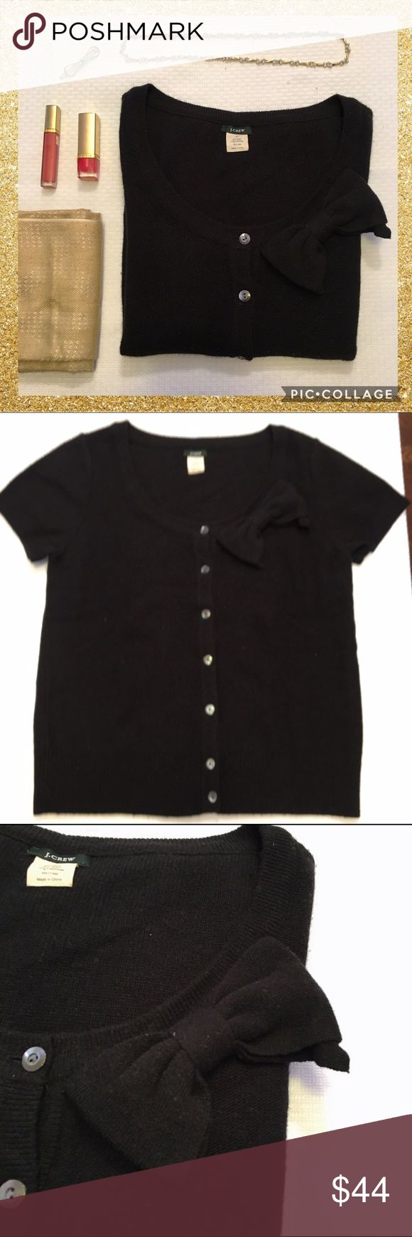 J. Crew short sleeve black bow cardigan Adorable black J. Crew short sleeve bow cardigan.  Wool and cashmere blend.  Has some polling as pictured in the 4th photo. J. Crew Sweaters Cardigans