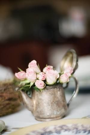 roses in a vintage silver tea pot