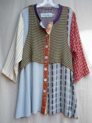 Nothing matches tunic top - love the mix of fabrics and the attached vest