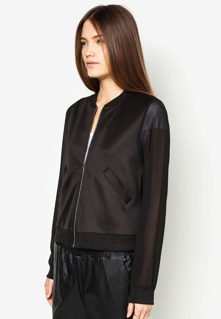 Zip Up Bomber Jacket by Something Borrowed. Black bomber jacket, made from polyester combination fabric. Round neck, with sheer black fabric for the sleeves and the back. Front zipper, 2 pockets in front, ribbed cuff hem. http://www.zocko.com/z/JHh3h