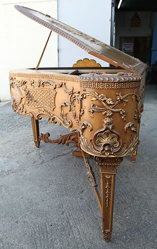 An Extremely Rare, Claviano Grand Piano For Sale with an Ornately Carved, Rococo Style Case with Gilt Detail and Hand Painted Panels. Piano Reputedly Built for Songwriter and Film star Ivor Novello. The Keyboard Spans Five and a Half Octaves and Has Been Strung Using Bichords