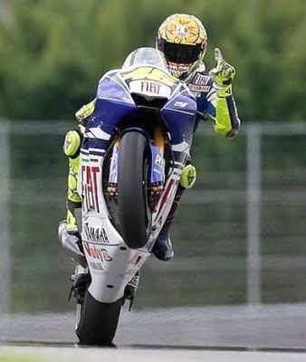 Rossi races & wheelies, no big deal