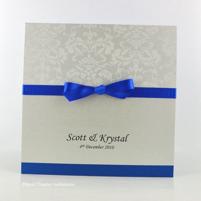 CASTLEREAGH  A stunning combination of royal blue and Florentine White brocade paper creates an invitation that exudes regal elegance. It is finished with a royal satin ribbon and comes with a matching metallic cream envelope. $5.95 https://www.facebook.com/NextChapterWeddingInvitations