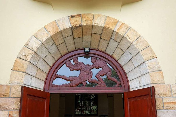 Mitford Barberton also contributed the teak carvings in the fanlights above several of the entrances to the school, RBHS