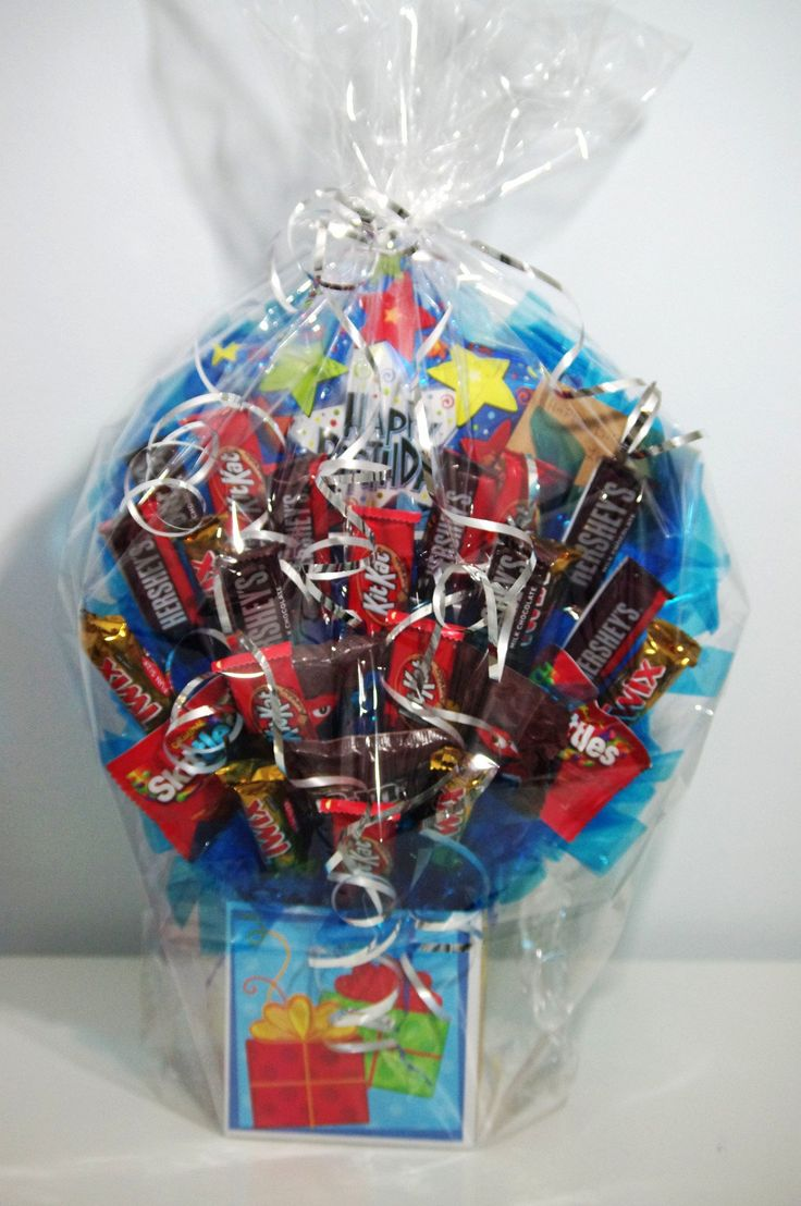 A handmade arrangement of your favorite candy in a birthday box with a birthday balloon. Arrangement contains a mixture of candy including Kit Kat, Skittles, Tw