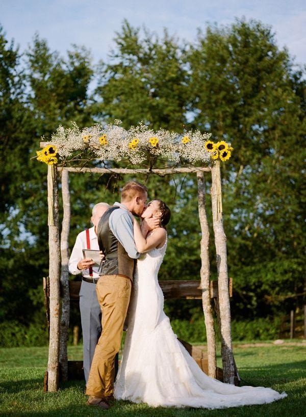DIY arbor with sunflowers and babys breath #diy #weddingceremony #weddingchicks http://www.weddingchicks.com/2014/03/13/homespun-antique-farm-wedding/
