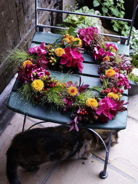 late summer flower garlands | ... , berry branches and yellow dahlia flower arranged in a heart shape
