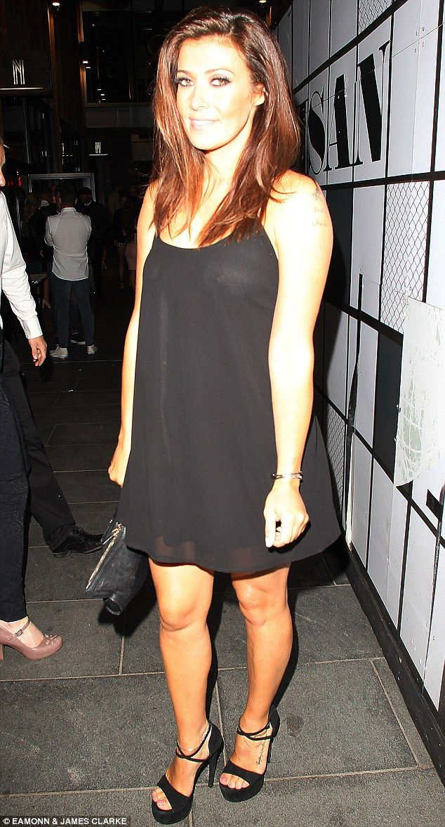 Slightly sheer:Kym Marsh wore a flimsy black dress during a night out in Manchester on Saturday