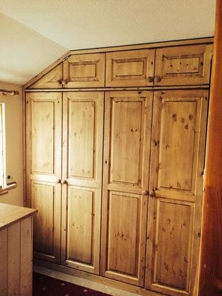 Fitted wardrobes Cornwall. Beautiful solid wood fitted wardrobes made by our specialist team.