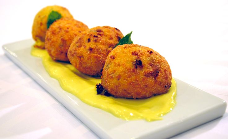 "Sweet pumpkin fritters with ""xinomizithra cheese"", mint & Cretan herbs laid on ginger based mayonnaise"