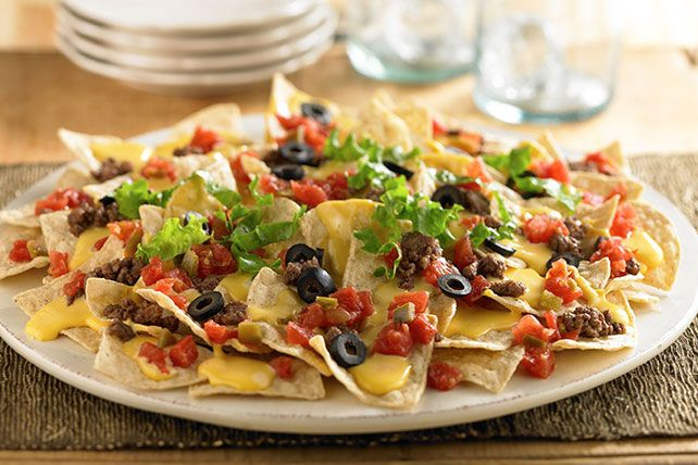 VELVEETA Loaded Nachos Recipe -             Need a last-minute party snack? With a bit of creamy Liquid Gold on hand, this is the fastest way to please the crowd. For more Endless Gold recipes visit: velveeta.com