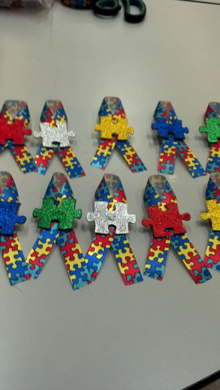 Autism Awareness pins.