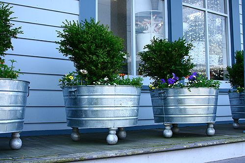 Galvanized tubs.. if you want some color, rub the outside of the tubs with white vinegar to remove chemical coating then spray paint your favorite colors!  Oh.. and add some ball feet!