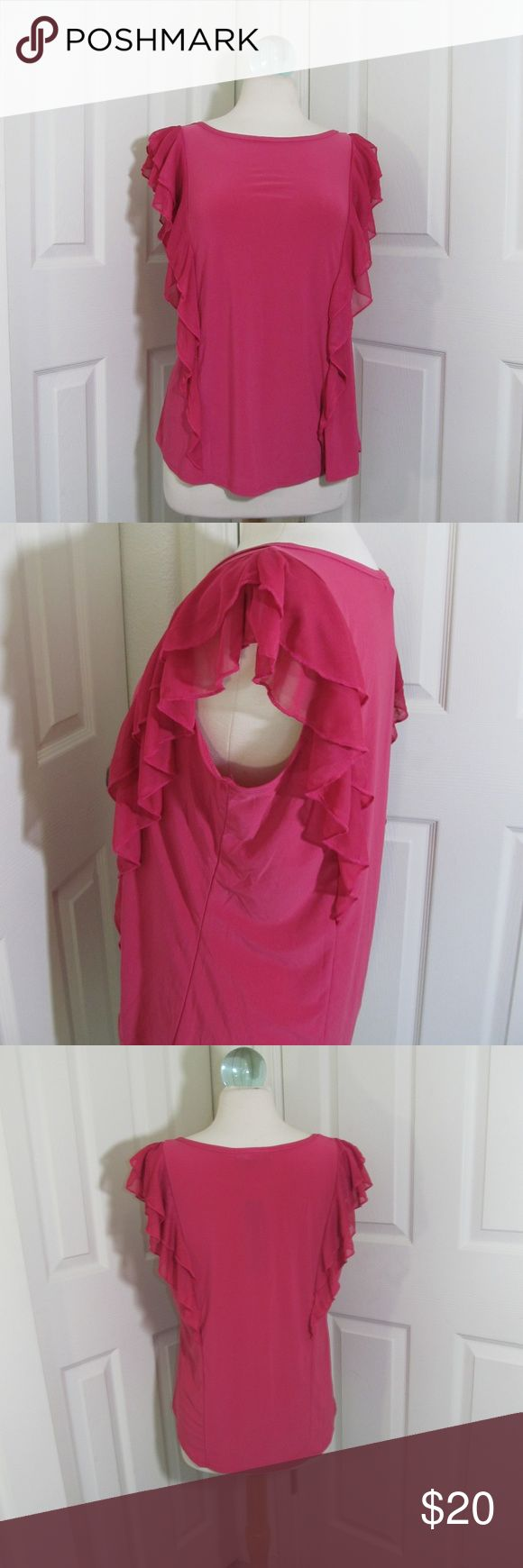 Adele & May Hot Pink Ruffle Blouse About this item: You'll be the center of attention in this flirty hot pink blouse. The chiffon ruffles create little cap sleeves, but it is sleeveless. The back and front look very similar, but the front's ruffles extend down to the straight hem, but end at the waist in the back. Gorgeous date night top!  Material: Polyester 95%, Spandex 5% Adele & May Tops Blouses