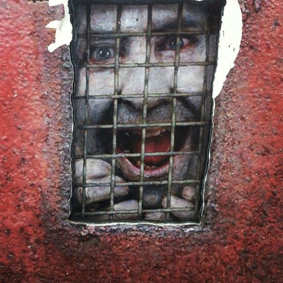 Crazy streetart Stavanger, Norway. Man in wall prison...
